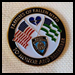 "Pin with the U.S. flag and NYPD flag. Reads ""Families of Fallen NYPD"" and ""to honor and remember"""